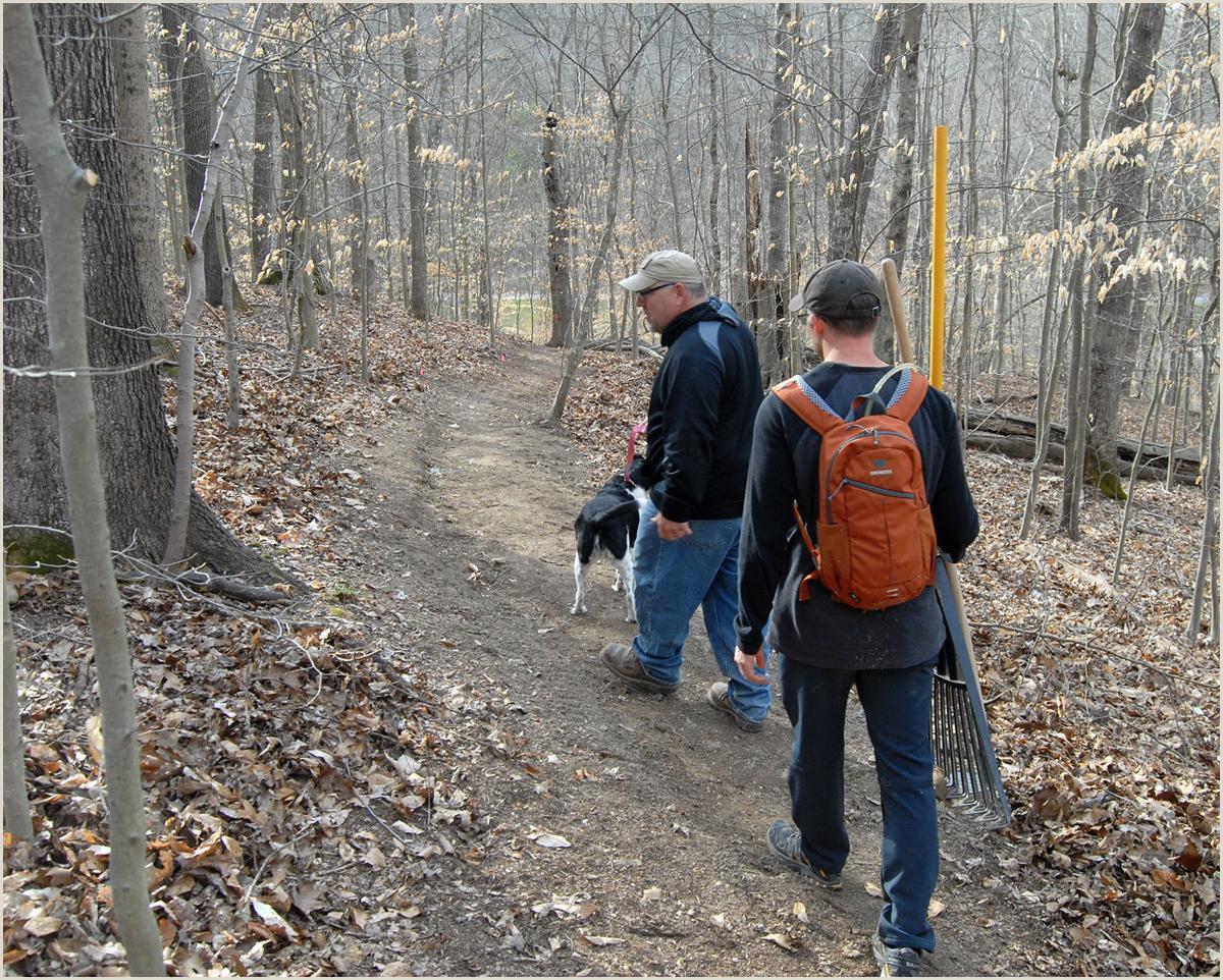 Volunteers establishing new biking hiking trail at Ridenour