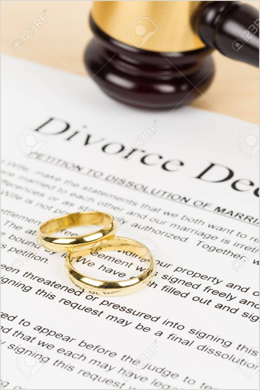 Wooden judge gavel golden rings and divorce decree document